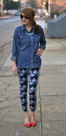 woman in floral pants and denim top