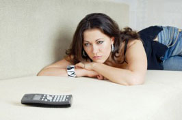 Woman waiting for phone to ring