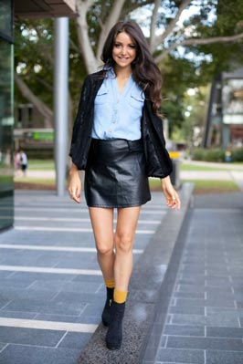 Australian supermodel Aley Greenblo in denim shirt and leather mini-skirt