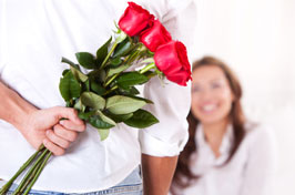Man spoiling woman with flowers