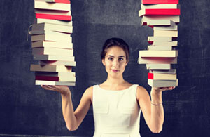 woman holding up books