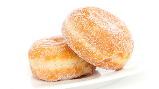 Two doughnuts sprinkled with sugar.