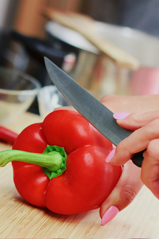 Red paprika being chopped.