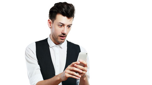 man amazed by gadget in hand