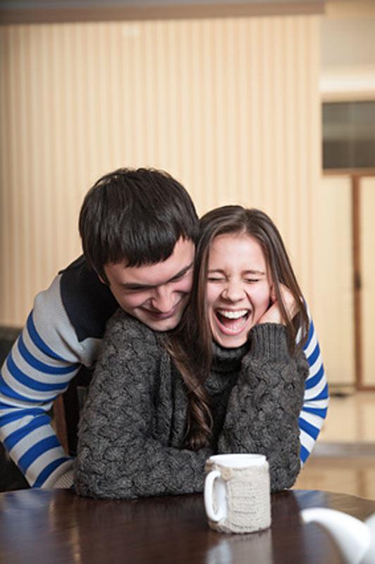 girl getting tickled by boyfriend