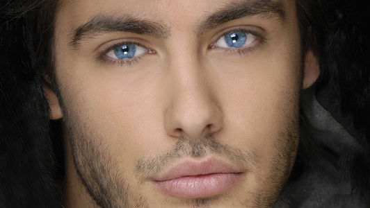 Guy with bright blue eyes.