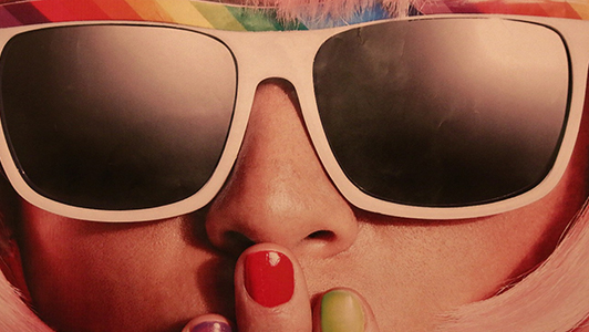 Girl with retro sunglasses and nails of different colour