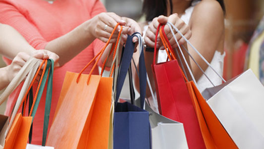 group of women with shopping bags held in