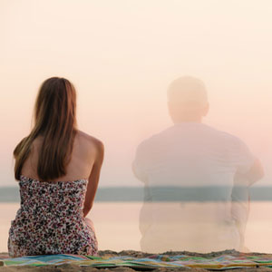 women sitting watching sunset in absence of man