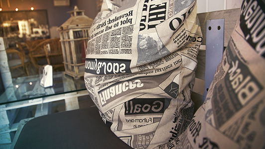 Pillows with newspaper print.