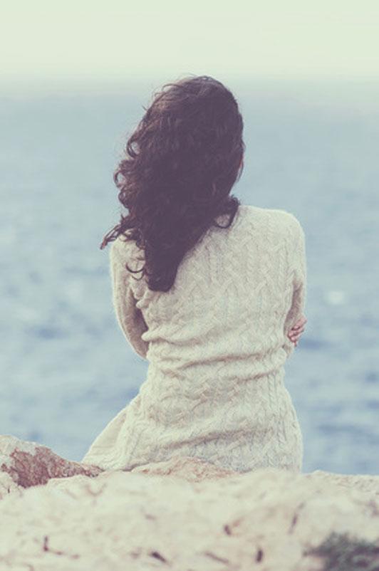 worried girl looking over sea