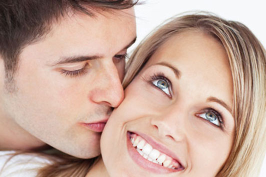 happy woman being kissed getting along with boyfriend