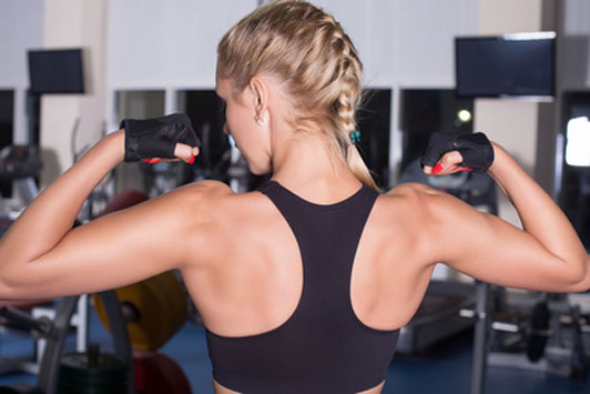 girl flexing back muscles