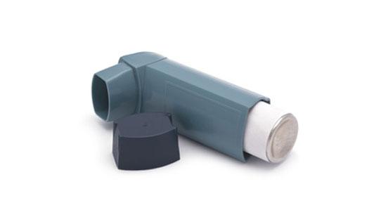 grey inhaler on white background