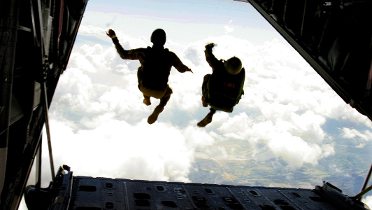 Couple jumping out of a plane.