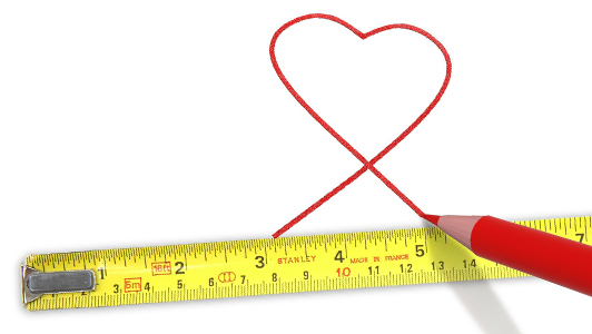 Measuring tape and a heart drawn with a red pencil.