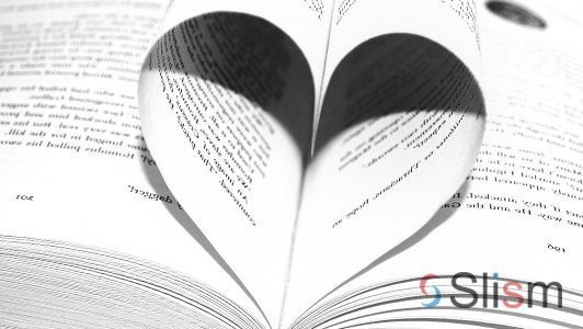 A book with two sheets shaping a heart