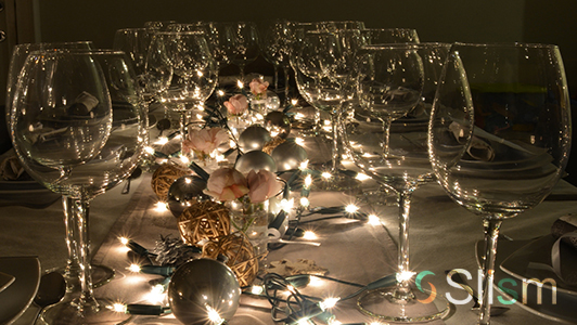 Elegant dining table with ornaments and elegant glasses