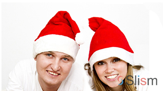 a couple wearing christmas hats