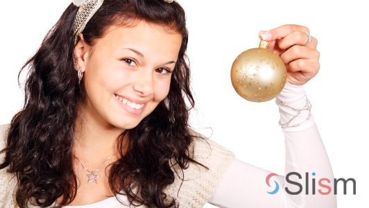 girl holding a christmas decoration