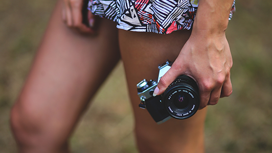 Girl taking pictures with a camera