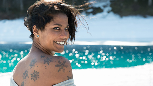 Pretty girl with a tattoo on her back smiling
