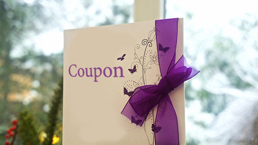 White coupon with purple bow and butterflies