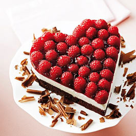 A heart shaped cake with raspberries