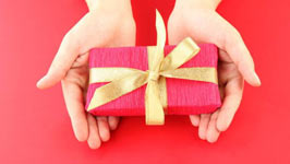 Pink present with gold ribbon
