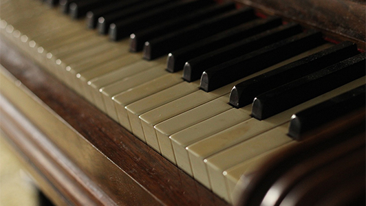 close-up of an old piano
