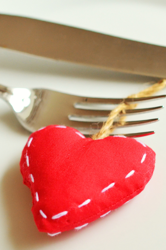 Red Fabric Heart Attached To A Fork