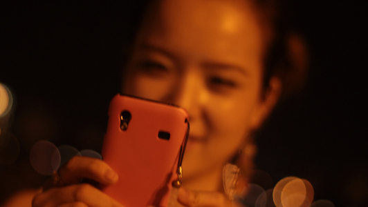 Girl taking a picture with her phone.