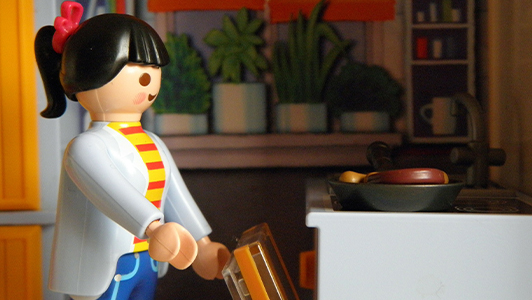 A lego doll cooking.