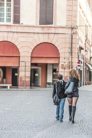 man walking next to tall woman