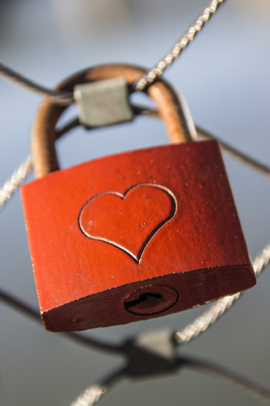 Brown padlock with an engraved heart.
