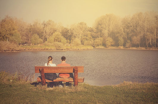 couple on bench near lake