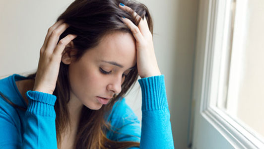 depressed young woman in blue