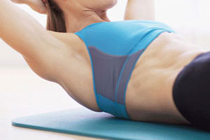 woman exercising abdominals