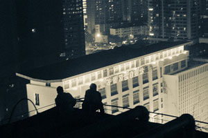 two people talking on a roof