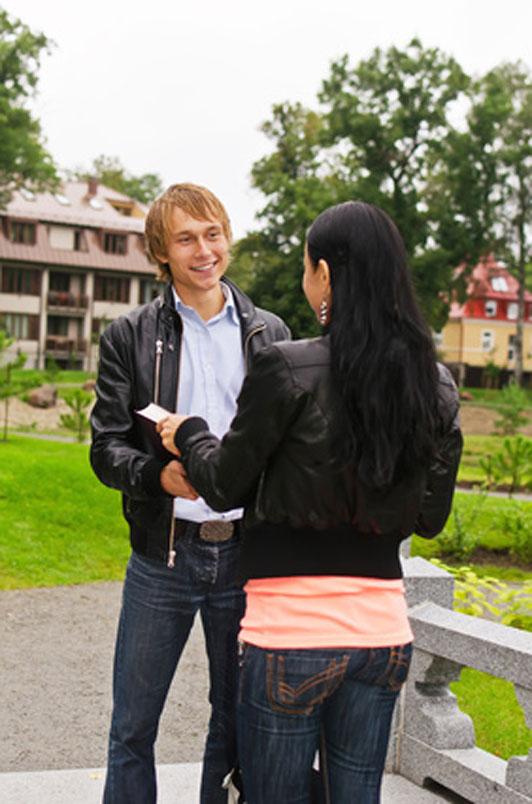 guy in black jacket talking to girl