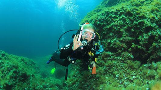 scuba woman giving okay sign