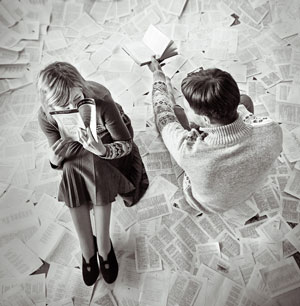 two people sitting together over newspaper