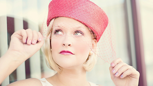 Blonde girl with a pink hat with a net.
