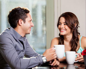 guy and girl on first date drinking coffee