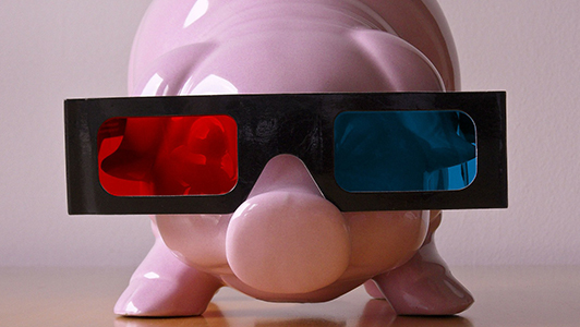 Pink piggy bank with 3d glasses.