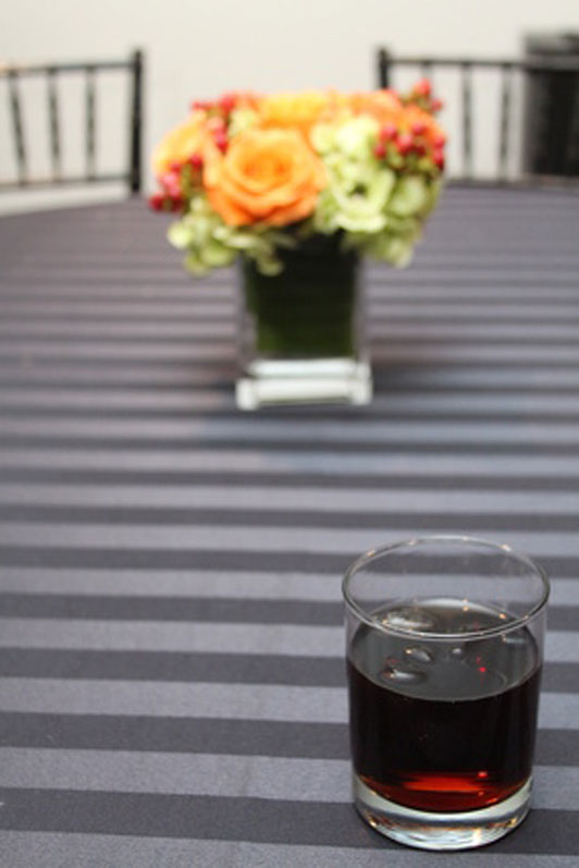 soda pop and flowers on table