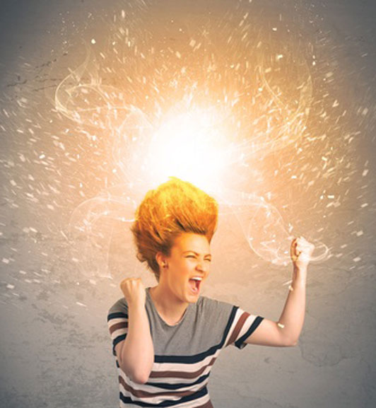 woman in shirt with hair bursting with energy