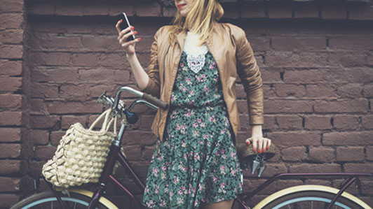 woman with bike texting