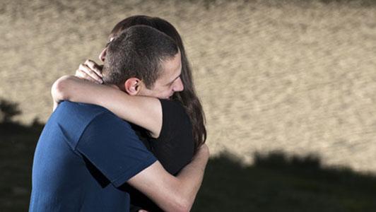 two people hugging goodbye