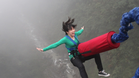 Girl in green shirt bungee jumping.